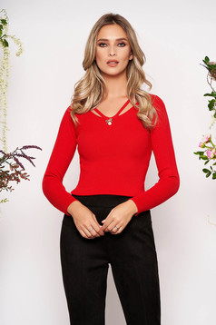 Red knitted tented women`s blouse long sleeve with v-neckline front cut-out design accessorized with breastpin