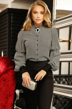 Black elegant from veil fabric flared women`s blouse accessorized with breastpin