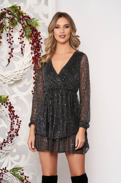 Dress black with sequin embellished details with v-neckline flaring cut long sleeved accessorized with tied waistband short cut