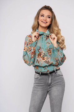 Turquoise women`s blouse casual long sleeve flared short cut from veil fabric