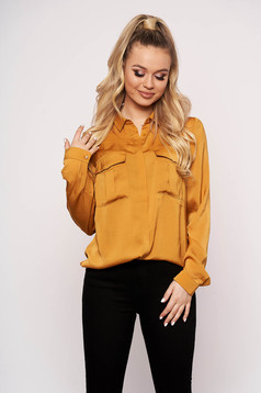 Yellow women`s shirt casual from satin short cut flared with pockets long sleeved
