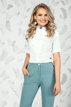 White women`s shirt elegant short cut tented short sleeves accessorized with breastpin