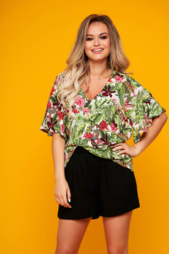 White women`s blouse casual with ruffle details flared with floral print