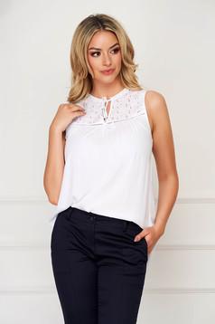 White women`s blouse casual sleeveless flared