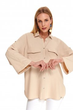 Peach women`s shirt casual with easy cut large sleeves
