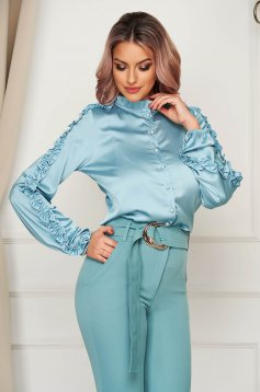 Women`s shirt mint elegant flared with puffed sleeves from satin fabric texture