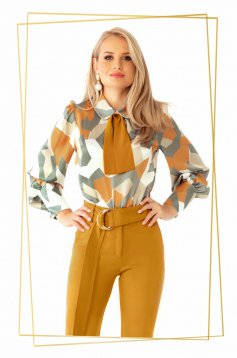 Women`s blouse mustard elegant flared with puffed sleeves from satin fabric texture with geometrical print