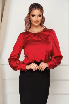 Red women`s blouse office flared from satin fabric texture