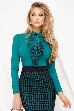 Green women`s blouse office tented cotton with ruffles on the chest accessorized with breastpin