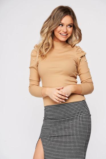 Cream elegant short cut cotton women`s blouse with turtle neck high shoulders tented
