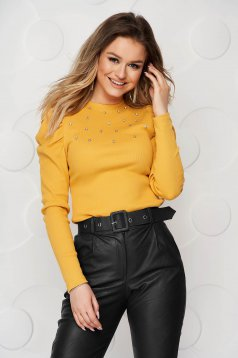 Mustard women`s blouse tented with crystal embellished details from striped fabric high shoulders
