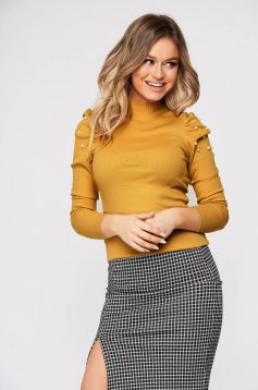 Mustard short cut cotton women`s blouse with turtle neck high shoulders tented from striped fabric