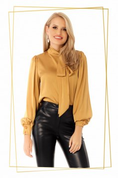 Mustard office flared women`s blouse from satin fabric texture