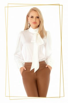 White office flared women`s blouse from satin fabric texture