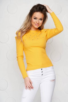 Yellow women`s blouse tented with crystal embellished details from striped fabric high shoulders