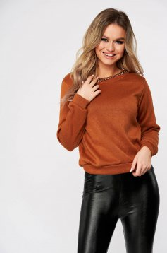 Brown sweater neckline metallic chain accessory
