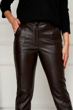 Brown trousers conical from ecological leather with pockets with easy cut