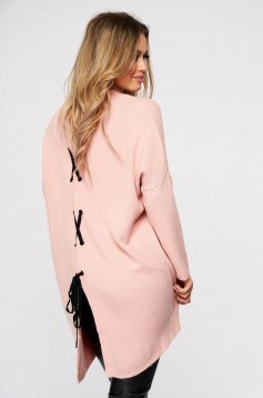 Pink women`s blouse from elastic and fine fabric knitted with easy cut ribbon fastening back slit