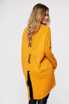 Mustard women`s blouse from elastic and fine fabric knitted with easy cut ribbon fastening back slit