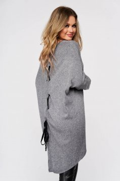 Grey women`s blouse from elastic and fine fabric knitted with easy cut ribbon fastening back slit