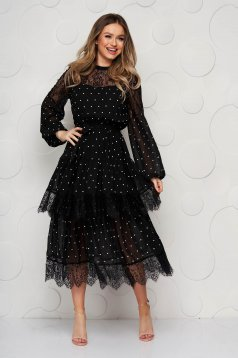 Black dress with lace details with dots print accessorized with tied waistband cloche midi