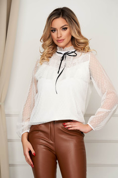 White women`s blouse elegant from tulle with turtle neck with ruffles on the chest flared