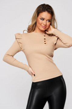 Cream women`s blouse tented from striped fabric with ruffle details with turtle neck