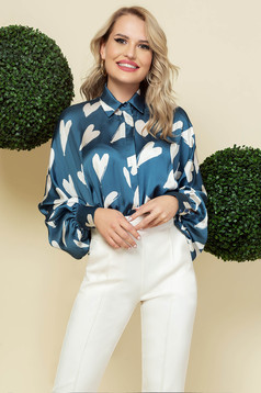 Blue women`s shirt office from satin fabric texture loose fit with puffed sleeves