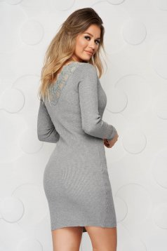 Grey dress knitted from elastic and fine fabric from striped fabric pencil with lace details