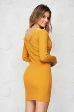 Mustard dress knitted from elastic and fine fabric from striped fabric pencil with lace details