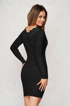 Black dress knitted from elastic and fine fabric from striped fabric pencil with lace details