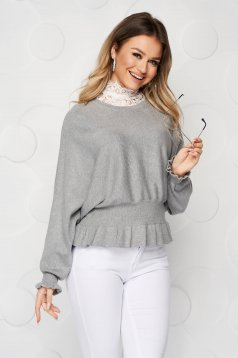 Grey women`s blouse casual knitted from elastic and fine fabric from striped fabric with ruffle details