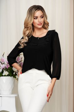 Black women`s blouse from elastic and fine fabric with ruffles on the chest occasional