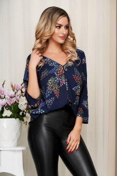 Women`s blouse blue with floral print v back neckline thin fabric