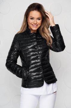 Black jacket tented from slicker metal eyelets fastening