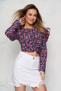Purple women`s blouse with floral print tented from wrinkled fabric high shoulders