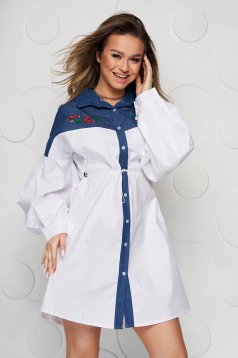 White women`s shirt is fastened around the waist with a ribbon loose fit