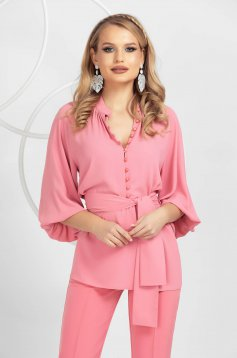 Pink women`s blouse from veil fabric accessorized with tied waistband with button accessories with puffed sleeves