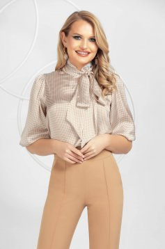 Cream women`s blouse from satin fabric texture with lace details
