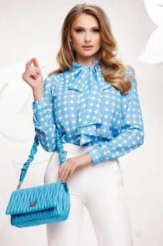 Blue women`s blouse dots print from veil fabric loose fit tied with bow