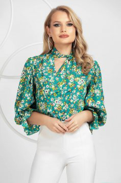 Women`s shirt from veil fabric with ruffled sleeves with floral print