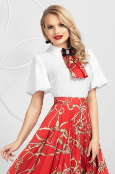 Red women`s blouse from veil slightly elastic fabric with puffed sleeves accessorized with breastpin