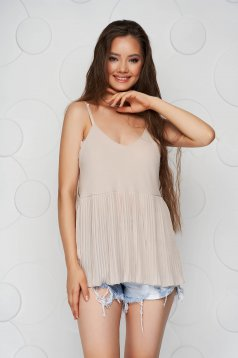 Cream top shirt loose fit folded up from veil fabric with straps
