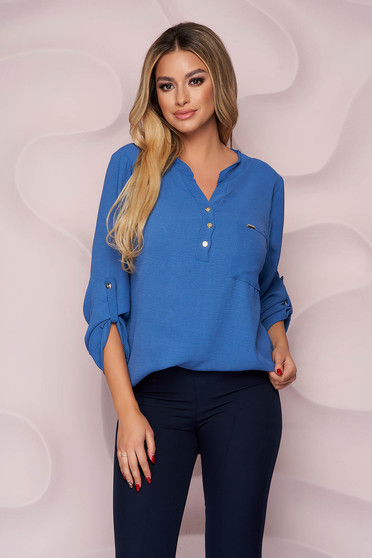 Women`s blouse loose fit wrinkled material a front pocket